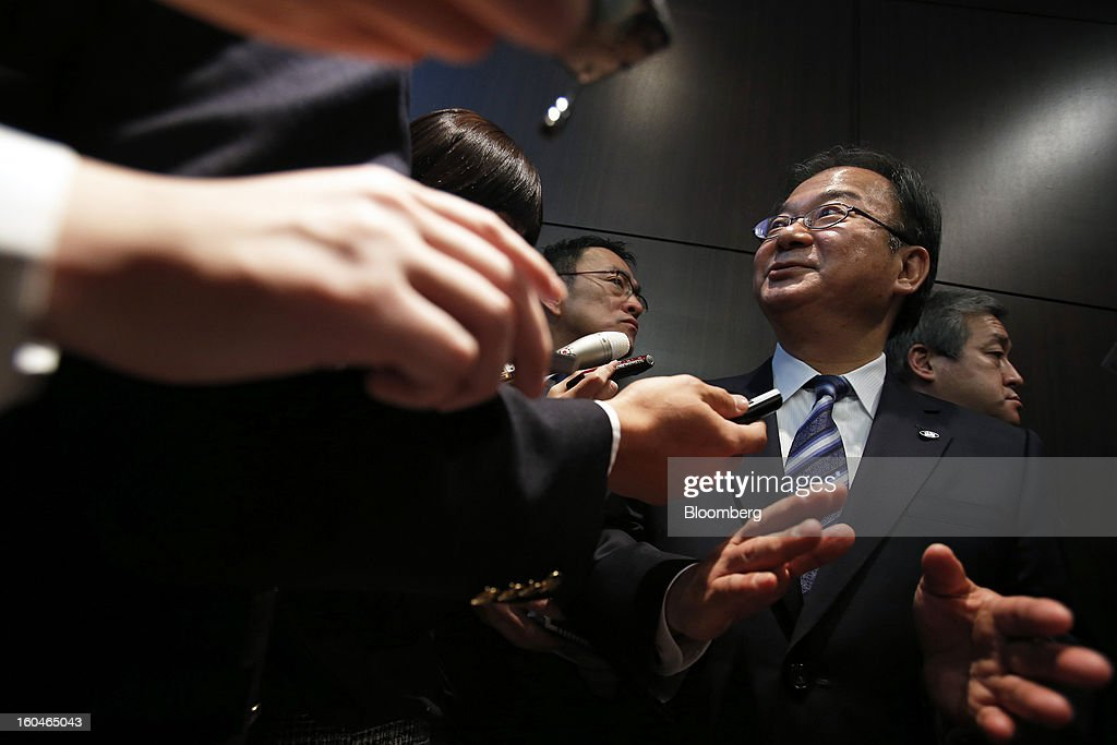 Takashi Okuda, president of Sharp Corp., gestures as he speaks to journalists following a news conference in Tokyo, Japan, on Friday, Feb. 1, 2013. Sharp Corp., the Japanese TV-maker that has warned about its ability to survive, posted a narrower loss helped by job cuts asset sales and a weaker yen. Photographer: Kiyoshi Ota/Bloomberg via Getty Images