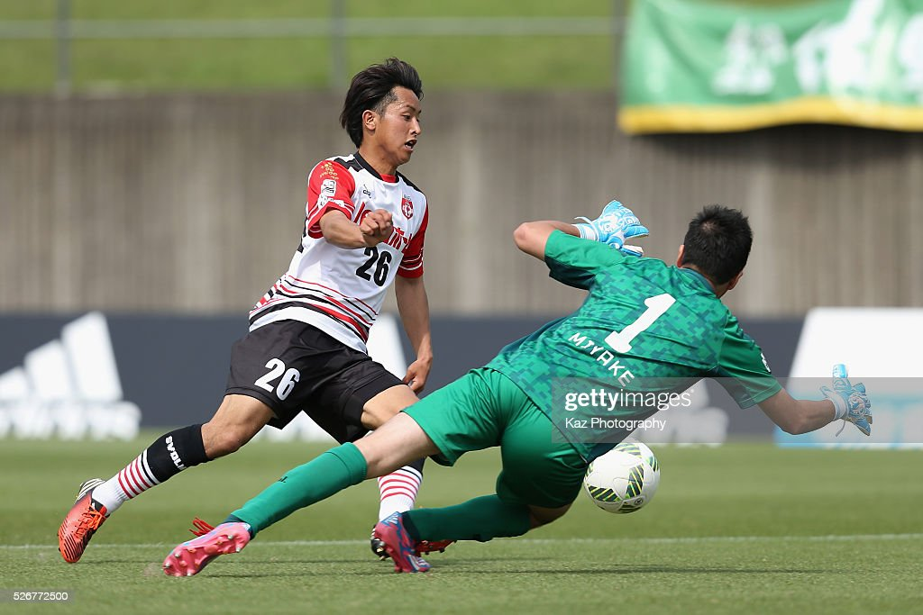 Takashi Saito of Grulla Morioka tries to go past Takanori Miyake of Fujieda MYFC during the J.League third division match between Fujieda MYFC and Grulla Morioka at the Fujieda Stadium on May 1, 2016 in Fujieda, Shizuoka, Japan.