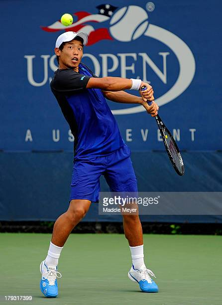 Takashi Saito of Japan in action during his boys' singles first round match against Maximilian Marterer of Germany on Day Seven of the 2013 US Open...