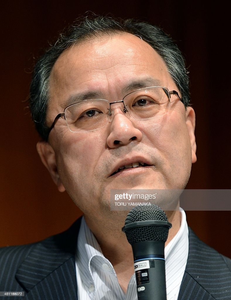 Takashi Tanaka president of Japan's telecom company KDDI answers questions during a press conference in Tokyo on June 25 2014 KDDI on June 25...