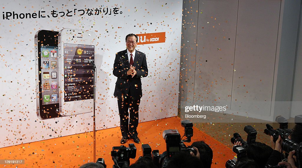 Takashi Tanaka president of KDDI Corp attends the launch event of the Apple Inc iPhone 4S at the company's shop in Tokyo Japan on Friday Oct 14 2011...