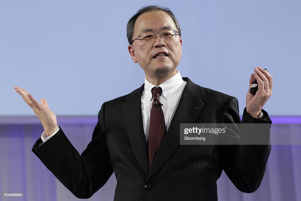 Takashi Tanaka president of KDDI Corp gestures as he speaks during the unveiling of the company's new products and services in Tokyo Japan on Tuesday...