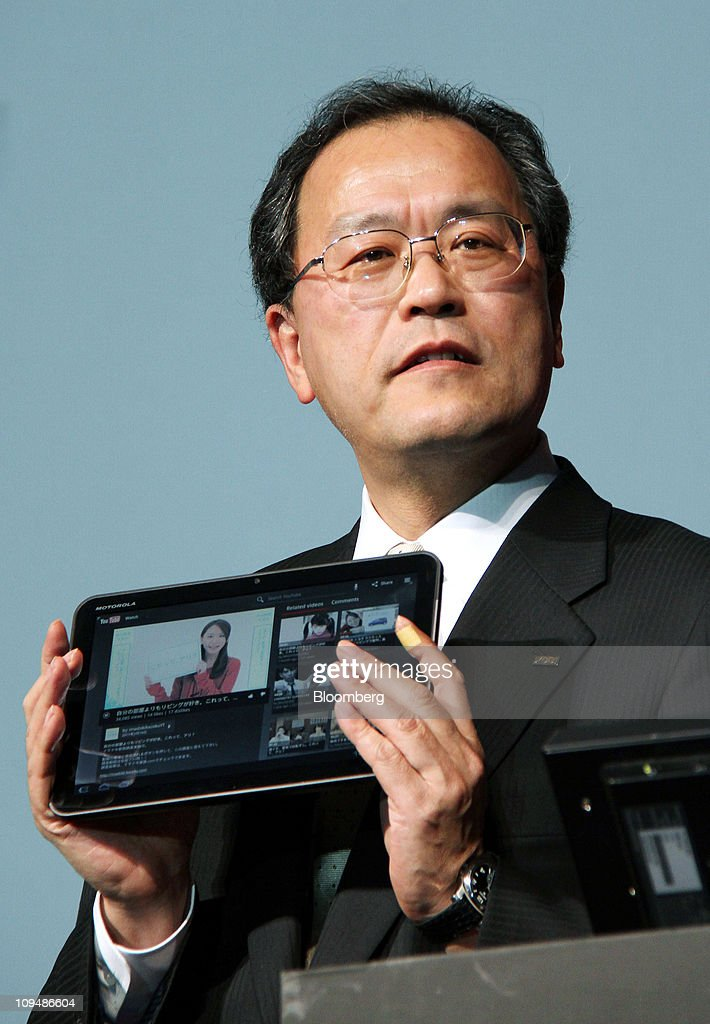 Takashi Tanaka, president of KDDI Corp., holds a Motorola XOOM tablet device manufactured by Motorola Mobility Inc. during an unveiling in Tokyo, Japan, on Monday, Feb. 28, 2011. KDDI is Japan's second-largest mobile-phone operator. Photographer: Haruyoshi Yamaguchi/Bloomberg via Getty Images