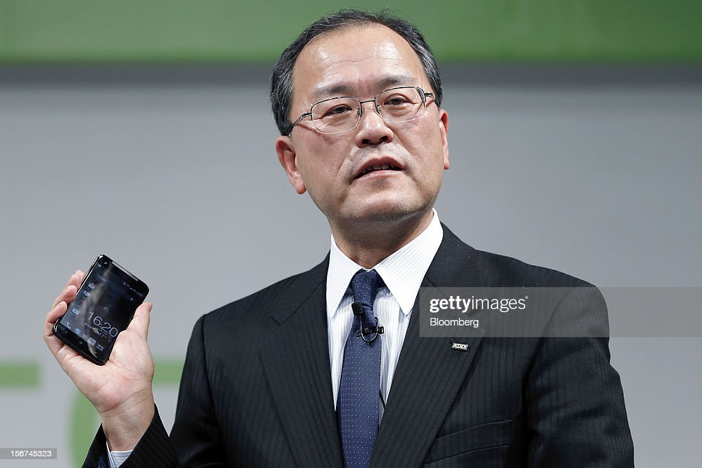 Takashi Tanaka president of KDDI Corp holds the HTC J Butterfly smartphone produced by HTCCorp during the unveiling event in Tokyo Japan on Tuesday...