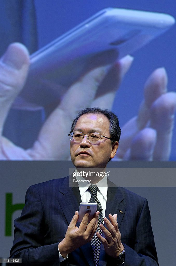 Takashi Tanaka president of KDDI Corp speaks during the unveiling of the HTC J smartphone manufactured by HTC Corp in Tokyo Japan on Friday April 20...