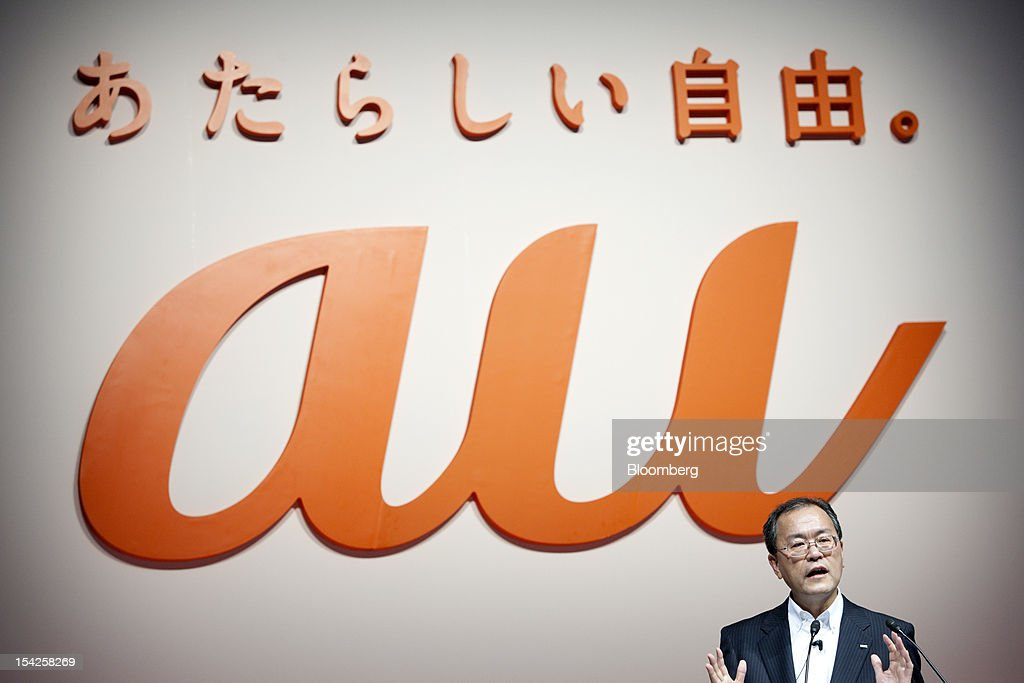 Takashi Tanaka, president of KDDI Corp., speaks during the unveiling of the company's new smartphone line-up in Tokyo, Japan, on Wednesday, Oct. 17, 2012. KDDI is Japan's second-largest mobile-phone carrier. Photographer: Tomohiro Ohsumi/Bloomberg via Getty Images