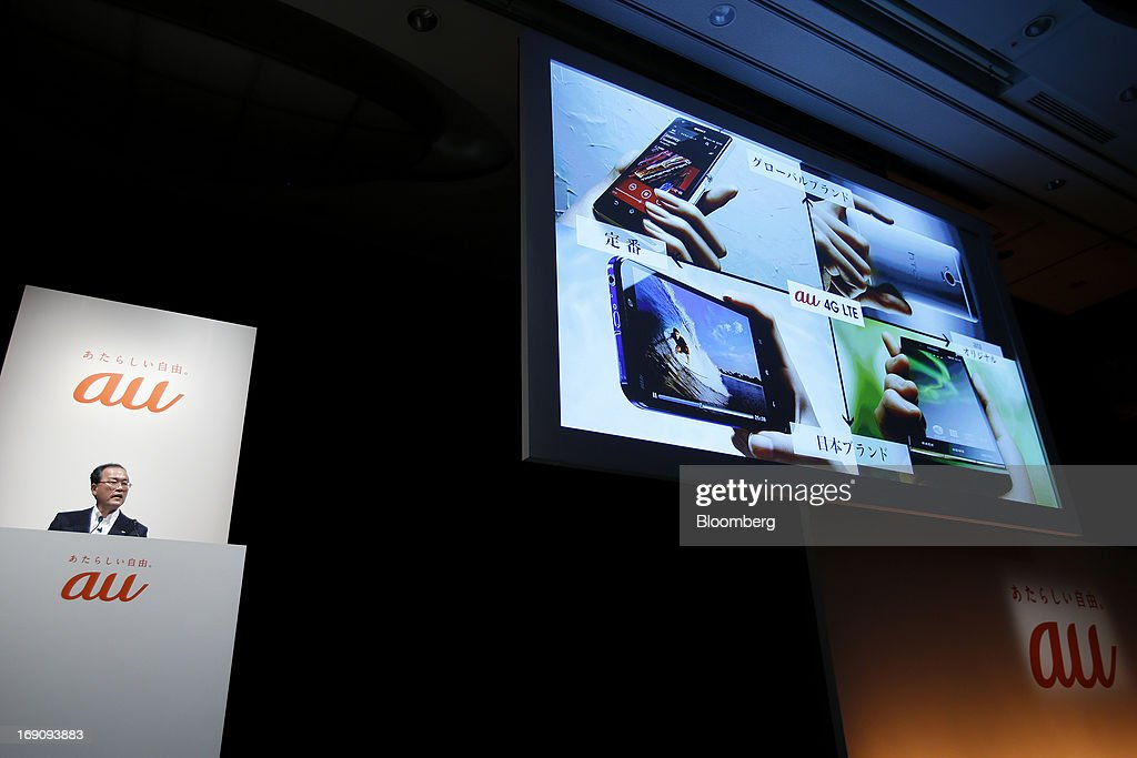 Takashi Tanaka president of KDDI Corp speaks during the unveiling of the company's new products and services in Tokyo Japan on Monday May 20 2013...