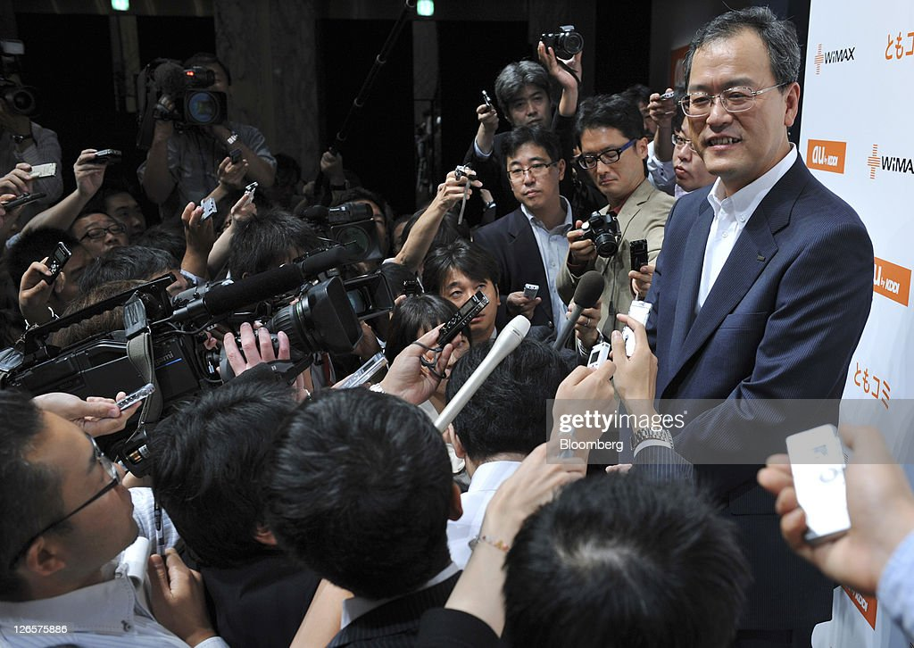 Takashi Tanaka president of KDDI Corp speaks to the media after a news conference unveiling the company's new products and services in Tokyo Japan on...