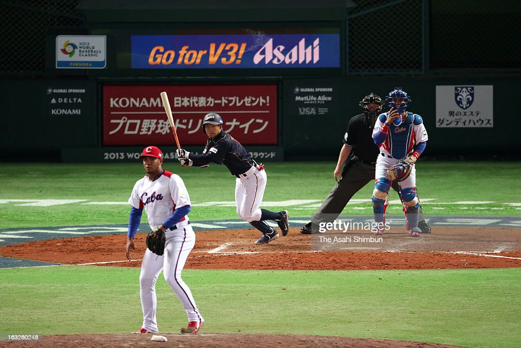 Takashi Toritani #1 of Japan hits a sacrifice fly in the top of ninth inning during the World Baseball Classic First Round Group A game between Japan and Cuba at Fukuoka Yahoo! Japan Dome on March 6, 2013 in Fukuoka, Japan.