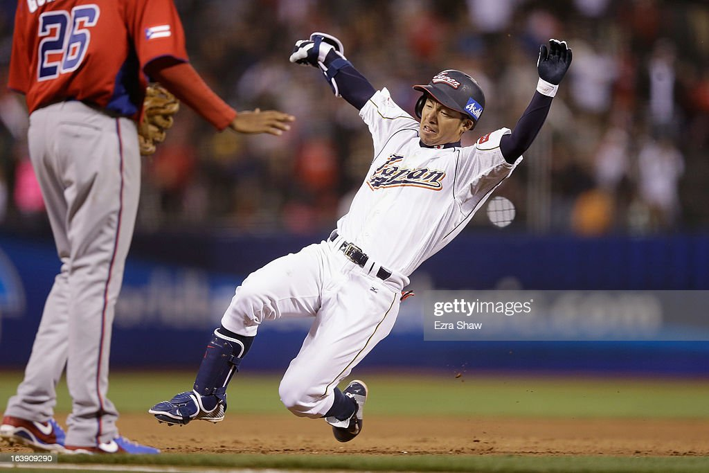 Takashi Toritani #1 of Japan slides safely in to third base for a triple in the eighth inning against Puerto Rico in the semifinals of the World Baseball Classic at AT&T Park on March 17, 2013 in San Francisco, California.