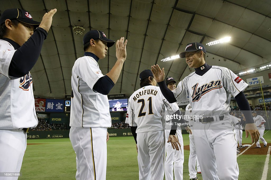 Takashi Toritani #1 of Team Japan greets his teammates during player introductions before Pool 1, Game 6 between the Netherlands and Japan in the second round of the 2013 World Baseball Classic at the Tokyo Dome on Tuesday, March 12, 2013 in Tokyo, Japan.