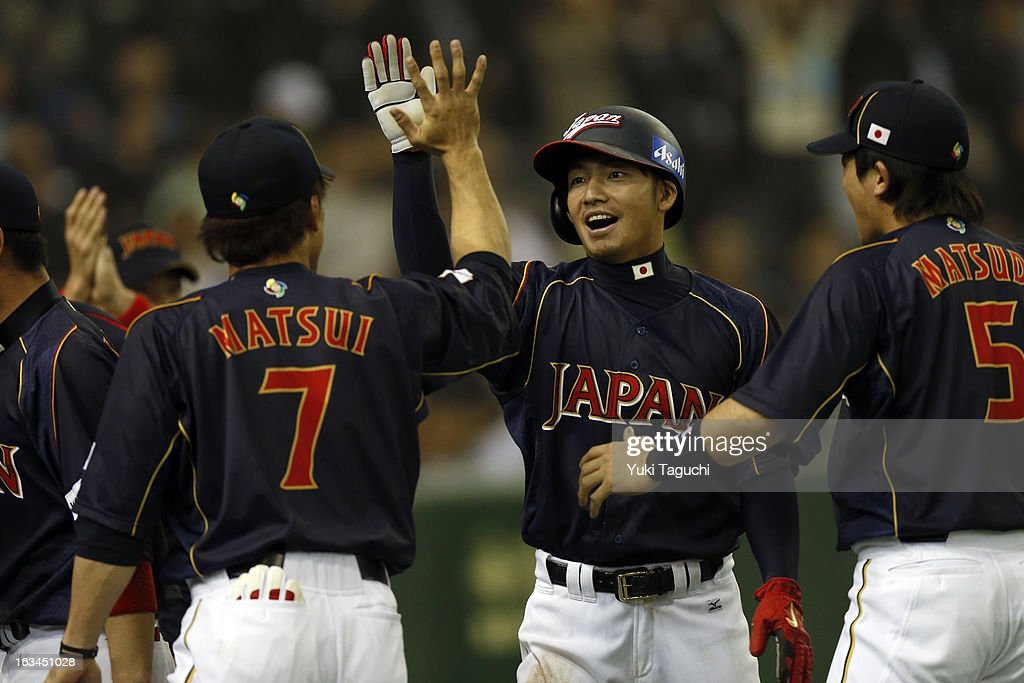 Takashi Toritani #1 of Team Japan is greeted by teammates after scoring the game tying run in the top of the ninth inning during Pool 1, Game 2 between Japan and Chinese Taipei in the second round of the 2013 World Baseball Classic at the Tokyo Dome on March 8, 2013 in Tokyo, Japan.