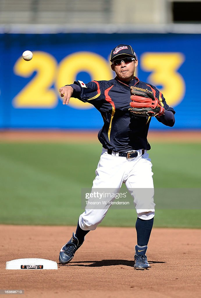 Takashi Toritani #1 of Team Japan makes a throw to first base during batting practice before playing Team Puerto Rico in the Semifinal Game 1 of the World Baseball Classic - Championship at AT&T Park on March 17, 2013 in San Francisco, California.