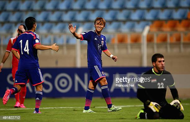 Takashi Usami celebrates his goal during the 2018 FIFA World Cup Asian Group E qualifying match between Syria and Japan at Seeb Stadium on October 8...