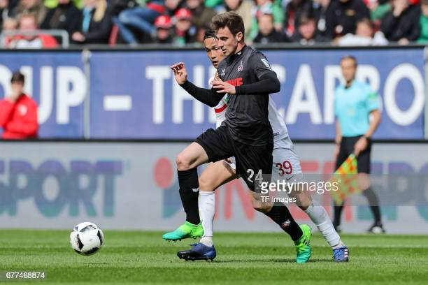 Takashi Usami of Augsburg and Lukas Kluenter of Colonge battle for the ball during the Bundesliga match between FC Augsburg and 1 FC Koeln at WWK...