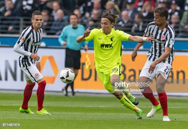 Takashi Usami of Augsburg challenges Timothy Chandler of Frankfurt during the Bundesliga match between Eintracht Frankfurt and FC Augsburg at...