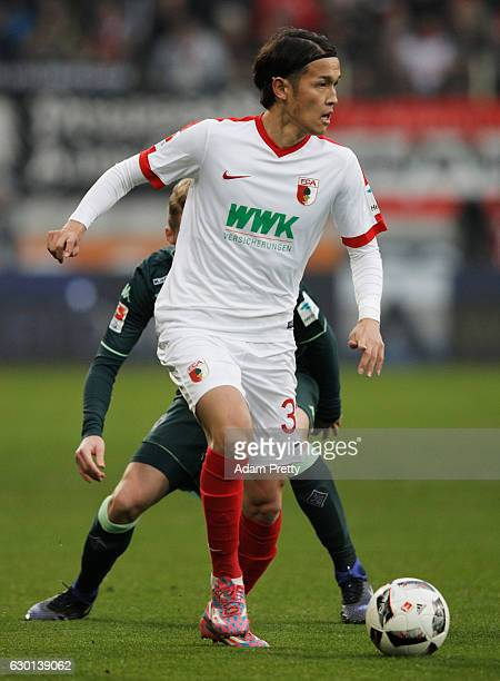 Takashi Usami of Augsburg in action during the Bundesliga match between FC Augsburg and Borussia Moenchengladbach at WWK Arena on December 17 2016 in...