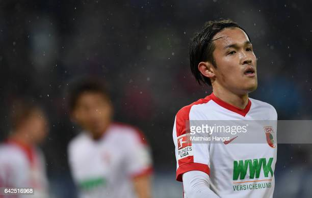 Takashi Usami of Augsburg shows his disappointment during the Bundesliga match between FC Augsburg and Bayer 04 Leverkusen at WWK Arena on February...