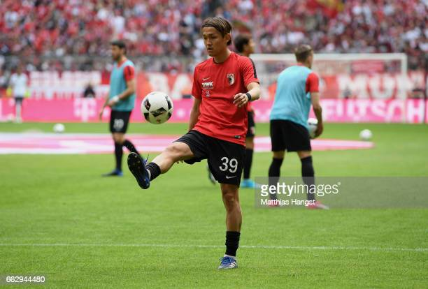 Takashi Usami of Augsburg warm up prior to the Bundesliga match between Bayern Muenchen and FC Augsburg at Allianz Arena on April 1 2017 in Munich...