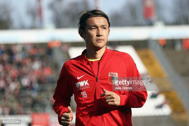 Takashi Usami of Augsburg warms up prior to the Bundesliga match between SV Darmstadt 98 and FC Augsburg at JonathanHeimesStadion am Boellenfalltor...