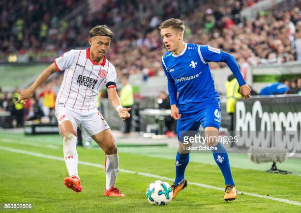 Takashi Usami of Duesseldorf and Marvin Mehlem of Darmstadt fight for the ball during the Second Bundesliga match between Fortuna Duesseldorf and SV...