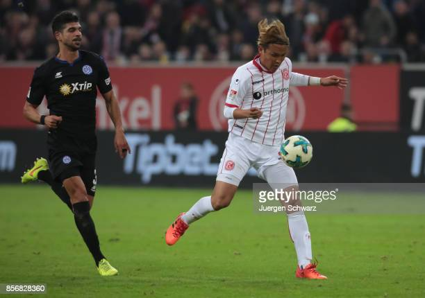 Takashi Usami of Duesseldorf controls the ball beside Tugrul Erat of Duisburg during the Second Bundesliga match between Fortuna Duesseldorf and MSV...