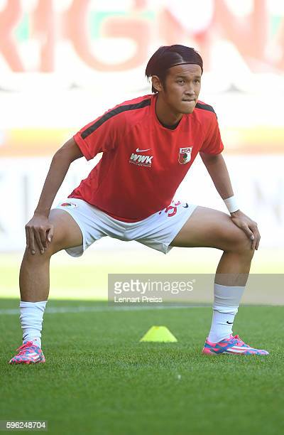 Takashi Usami of FC Augsburg warms up prior to the Bundesliga match between FC Augsburg and VfL Wolfsburg at WWK Arena on August 27 2016 in Augsburg...