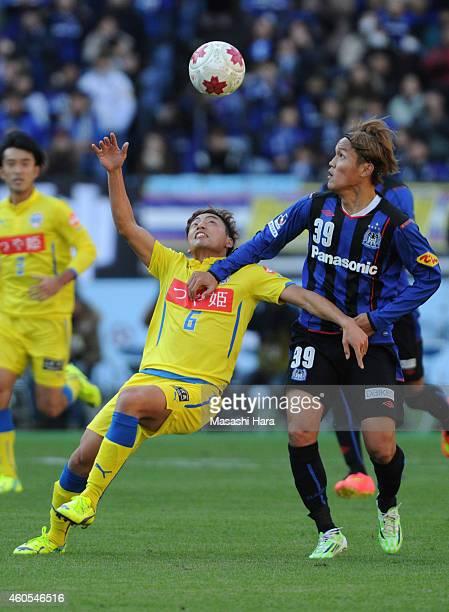 Takashi Usami of Gamba Osaka and Takumi Yamada of Montedio Yamagata compete for the ball during the Emperor's Cup final match between Gamba Osaka and...
