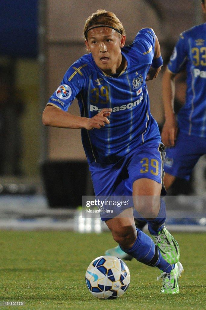 Takashi Usami of Gamba Osaka in action during the AFC Champions League Group F match between Gamba Osaka and Guangzhou RF at Expo '70 Stadium on...