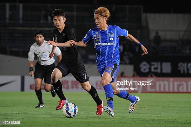 Takashi Usami of Gamba Osaka in action during the AFC Champions League Group F match between Gamba Osaka and Seongnam FC at Expo '70 Stadium on May 6...