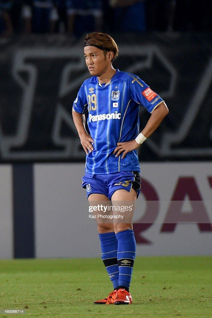 Takashi Usami of Gamba Osaka looks disappointed after the draw of the AFC Champions League semi final match between Gamba Osaka and Guangzhou...