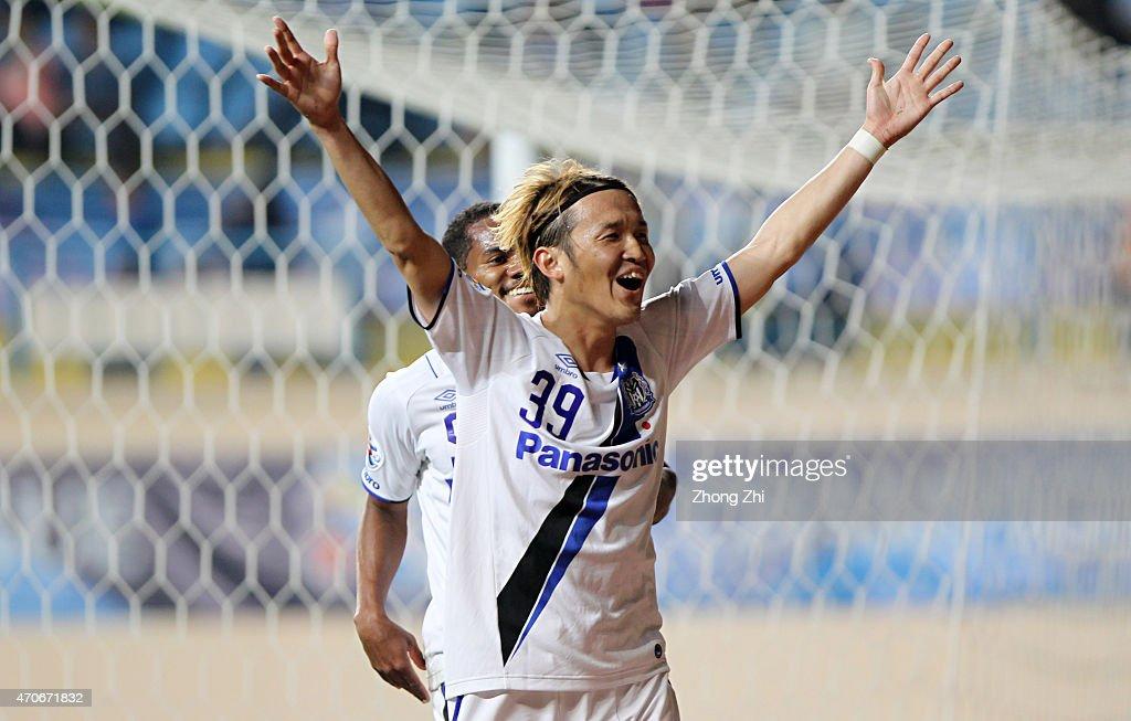 GUANGZHOU CHINA April 22 Takashi Usami of Gmaba Osaka celebrates his goal during the AFC Asian Champions League Group F match between Guangzhou RF...