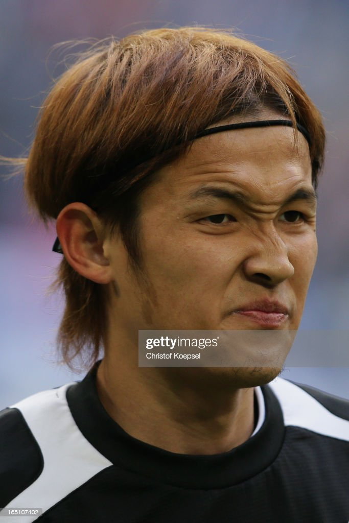 <a gi-track='captionPersonalityLinkClicked' href=/galleries/search?phrase=Takashi+Usami&family=editorial&specificpeople=2868240 ng-click='$event.stopPropagation()'>Takashi Usami</a> of Hoffenheim looks on prior to the Bundesliga match between FC Schalke 04 and TSG 1899 Hoffenheim at Veltins-Arena on March 30, 2013 in Gelsenkirchen, Germany.