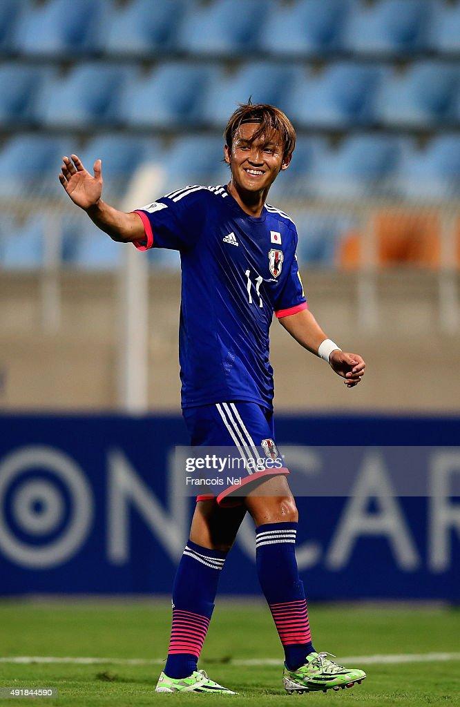 Takashi Usami of Japan celebrates his goalduring the 2018 FIFA World Cup Asian Group E qualifying match between Syria and Japan at Seeb Stadium on...