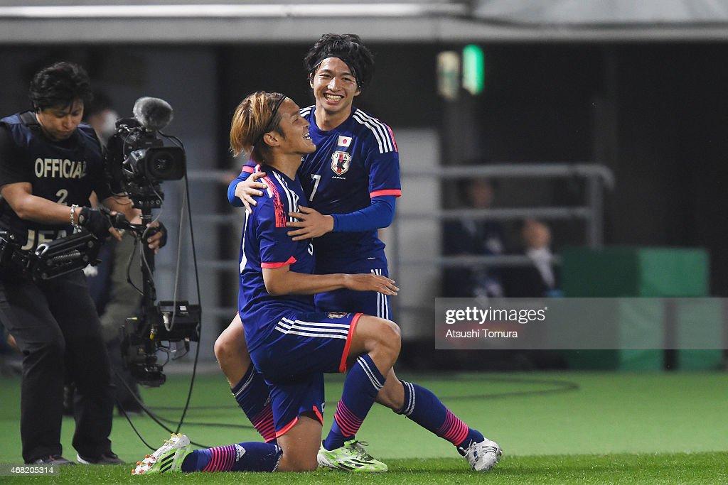 Takashi Usami of Japan celebrates his team's fourth goal with team mate Gaku Shibasaki of Japan during the international friendly match between Japan...
