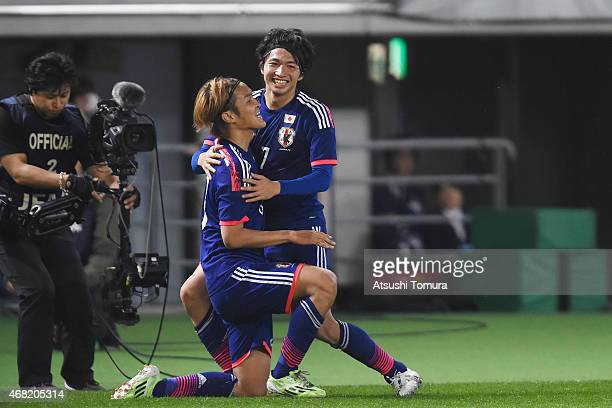 Takashi Usami of Japan celebrates his team's fourth goal with team mate Gaku Shibasaki of Japan during the international friendly match between Japan...