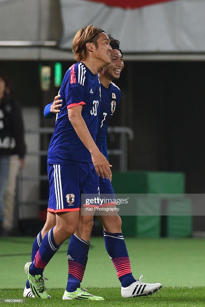 Takashi Usami of Japan celebrates Japan's 4th goal with Gaku Shibasaki of Japan during the international friendly match between Japan and Uzbekistan at Ajinomoto Stadium on March 31, 2015 in Tokyo, Japan.