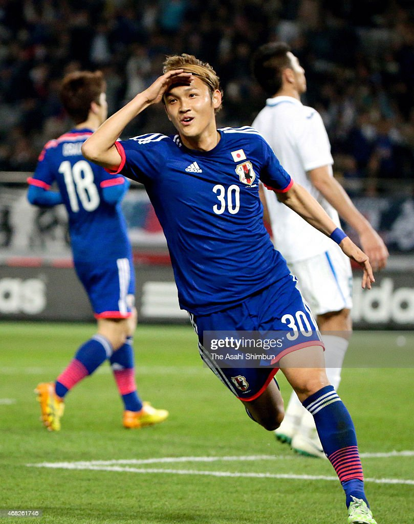 Takashi Usami of Japan celebrates scoring his team's fourth goal during the international friendly match between Japan and Uzbekistan at Ajinomoto Stadium on March 31, 2015 in Chofu, Tokyo, Japan.