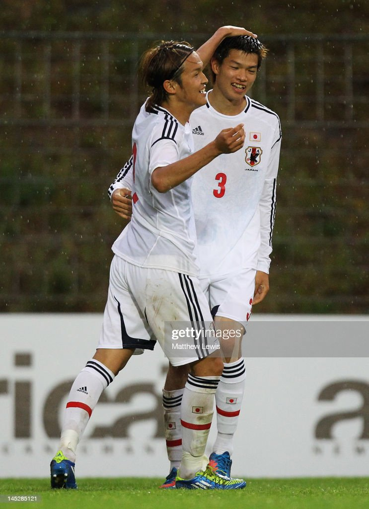 Takashi Usami of japan congratulates Takahiro Ohgihara on his goal during the Toulon Tournament Group A match between Japan and Netherlands at Stade...