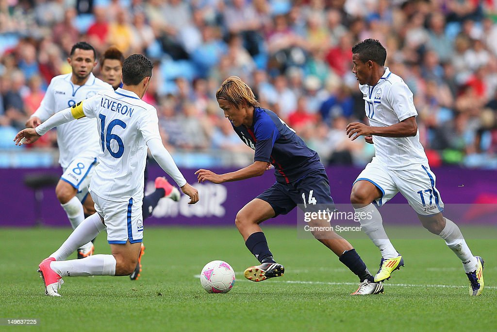 <a gi-track='captionPersonalityLinkClicked' href=/galleries/search?phrase=Takashi+Usami&family=editorial&specificpeople=2868240 ng-click='$event.stopPropagation()'>Takashi Usami</a> of Japan controls the ball during the Men's Football first round Group D Match between Japan and Honduras, on Day 5 of the London 2012 Olympic Games at City of Coventry Stadium on August 1, 2012 in Coventry, England.