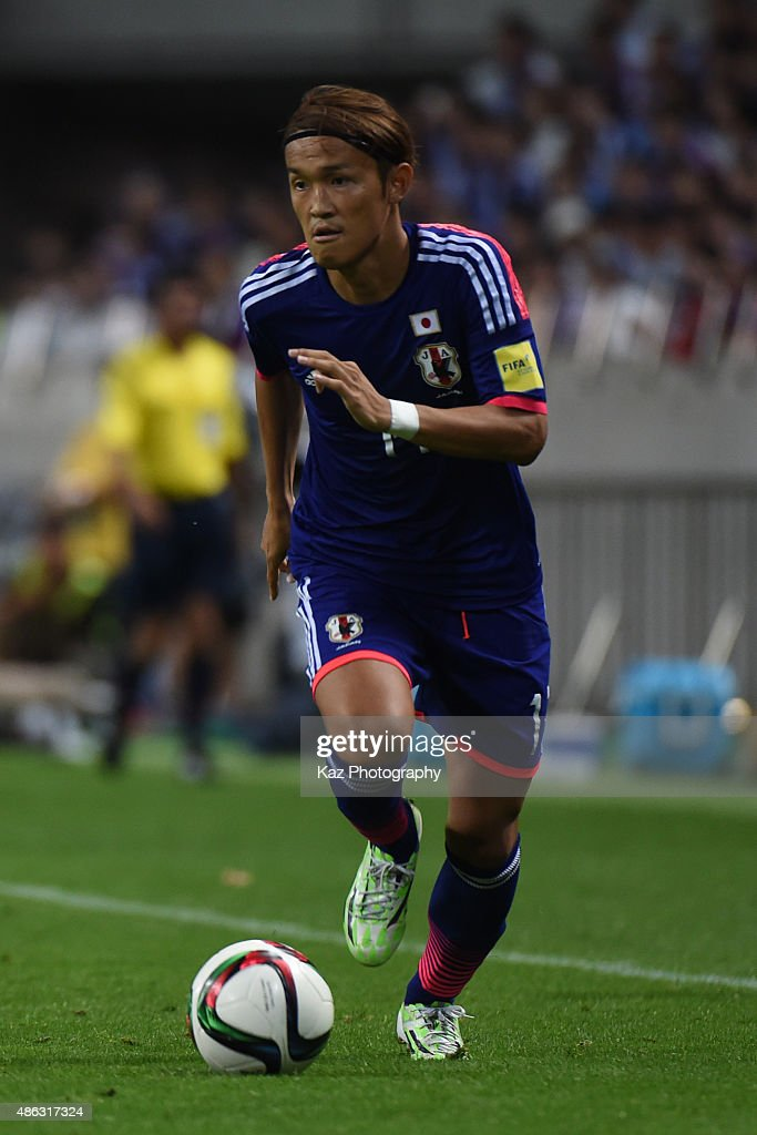 Takashi Usami of Japan dribbles the ball [action] during the 2018 FIFA World Cup Qualifier Round 2 Group E at Saitama Stadium on September 3 2015 in...