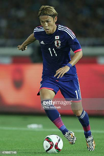 Takashi Usami of Japan looks to pass during the international friendly match between Japan and Iraq at Nissan Stadium on June 11 2015 in Yokohama...