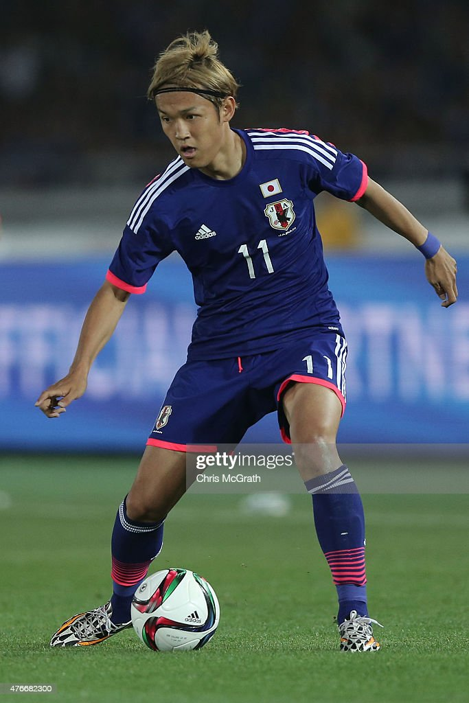 Takashi Usami of Japan looks to pass during the international friendly match between Japan and Iraq at Nissan Stadium on June 11 2015 in Yokohama...