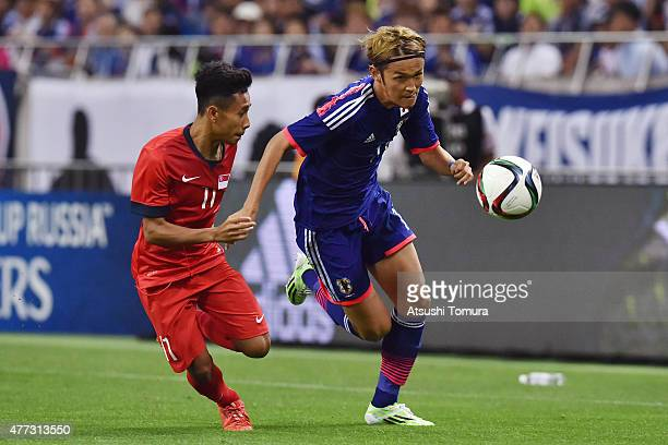 Takashi Usami of Japan runs with the ball during the 2018 FIFA World Cup Asian Qualifier second round match between Japan and Singapore at Saitama...