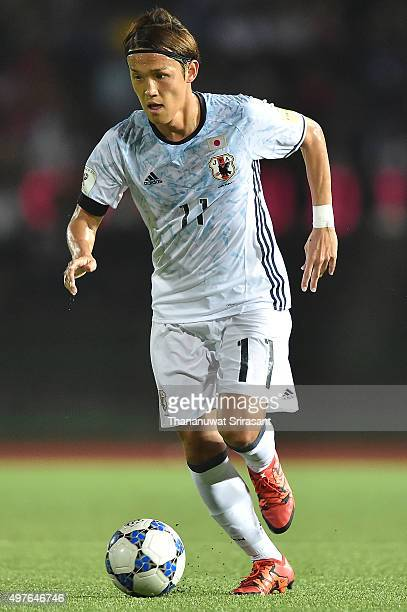 Takashi Usami of Japan runs with the ball during the 2018 FIFA World Cup Qualifier match between Cambodia and Japan on November 17 2015 in Phnom Penh...