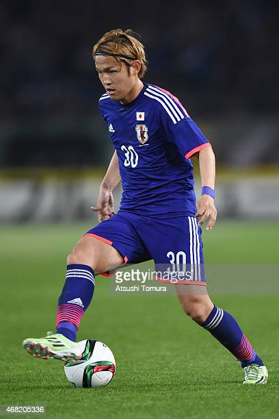 Takashi Usami of Japan runs with the ball during the international friendly match between Japan and Uzbekistan at Ajinomoto Stadium on March 31 2015...
