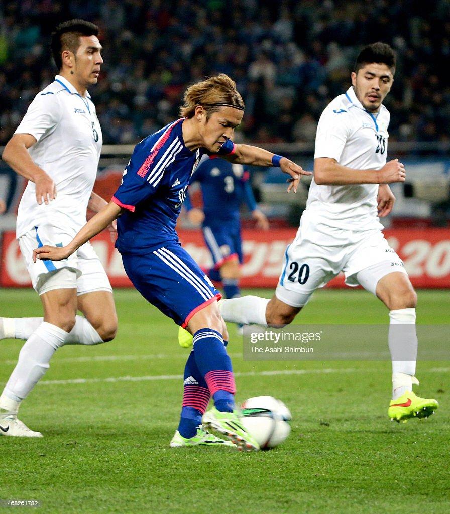 Takashi Usami of Japan scores his team's fourth goal during the international friendly match between Japan and Uzbekistan at Ajinomoto Stadium on March 31, 2015 in Chofu, Tokyo, Japan.