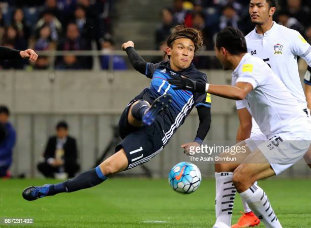Takashi Usami of Japan shoots at goal during the 2018 FIFA World Cup Qualifier match between Japan and Thailand at Saitama Stadium on March 28 2017...