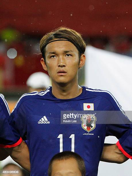 Takashi Usami of Japan stands on the field before the match against China during the EAFF East Asian Cup 2015 final round at the Wuhan Sports Center...