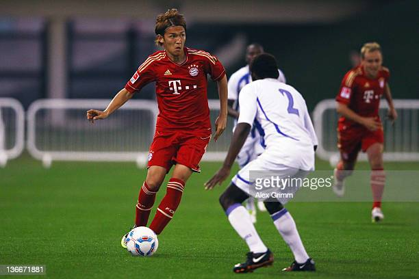 Takashi Usami of Muenchen controles the ball during a training match between Bayern Muenchen and a Under19 team of Aspire at ASPIRE Academy for...